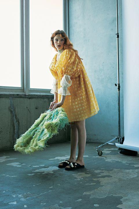 Green, Clothing, Yellow, Fashion, Dress, Fashion design, Leg, Textile, Photo shoot, Outerwear,