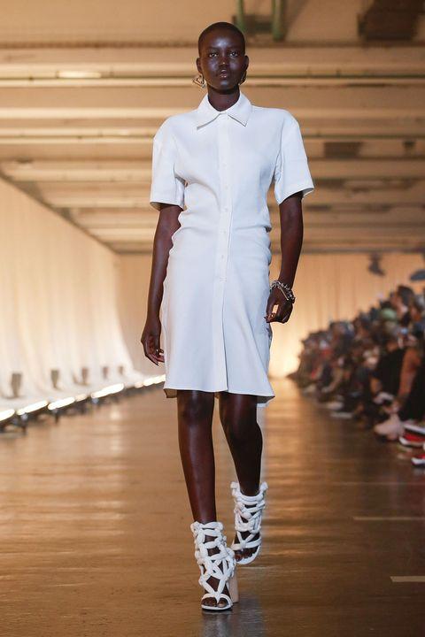 White, Fashion, Runway, Fashion model, Fashion show, Clothing, Fashion design, Footwear, Shoulder, Joint,
