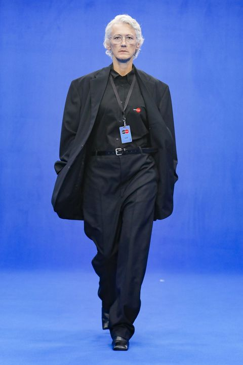 Fashion, Runway, Fashion show, Suit, Outerwear, Electric blue, Fashion design, Formal wear,