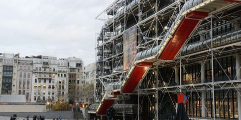Architecture, Construction, Crane, Vehicle, Building, Tourist attraction, Facade, City, Industry, Scaffolding,