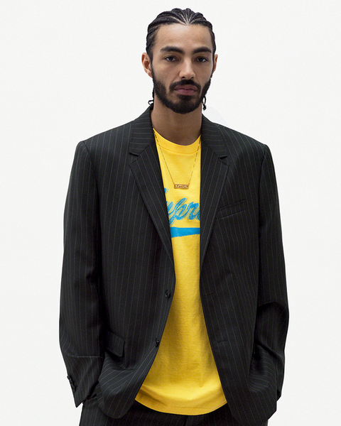 Yellow, Product, Outerwear, Jacket, Brand, Font, Suit, Logo, T-shirt, Sleeve,