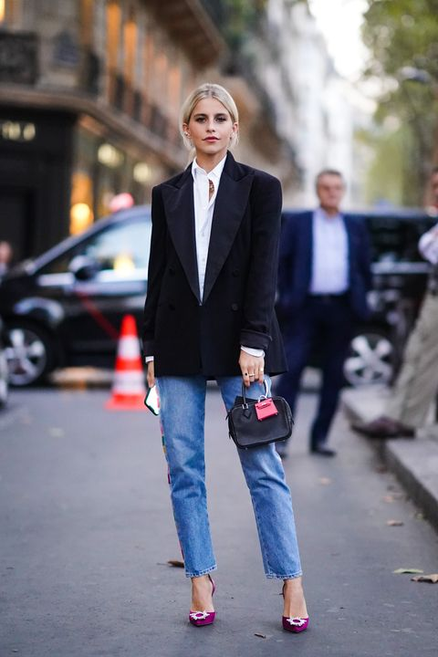 paris, france   september 28 caroline daur wears a white shirt, a black blazer jacket, a bag with an attached pink mini bag, blue cropped jeans, purple shoes, outside ralph lauren, during paris fashion week   womenswear spring summer 2020 on september 28, 2019 in paris, france photo by edward berthelotgetty images