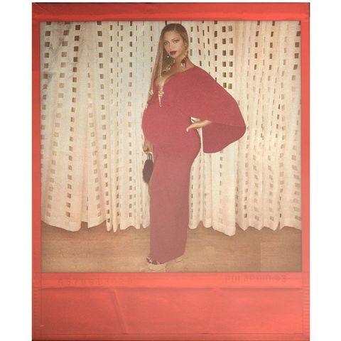 Textile, Maroon, Interior design, Carpet, Visual arts, Costume, Shawl,