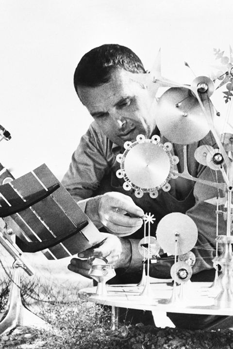 Charles Eames with Kinetic Metal Sculpture
