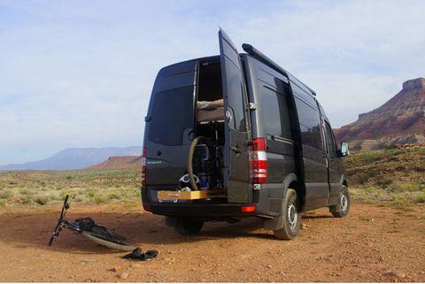 Motor vehicle, Mode of transport, Automotive exterior, Automotive mirror, Van, Landscape, Rim, Automotive tire, Hill, Fender,