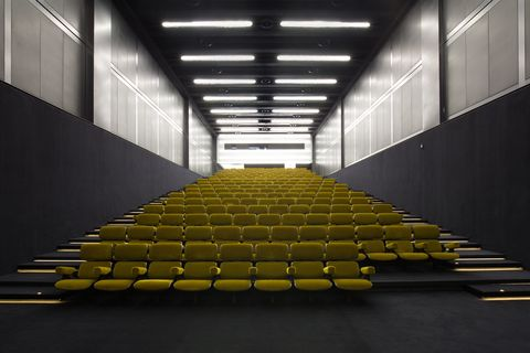 Yellow, Light, Architecture, Stairs, Line, Ceiling, Building, Auditorium, Daylighting, Symmetry,