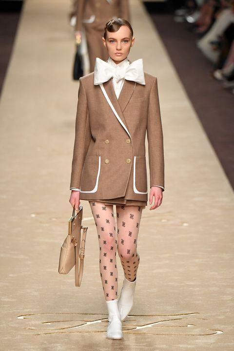Fashion, Fashion model, Runway, Fashion show, Clothing, Outerwear, Haute couture, Beige, Blazer, Human,