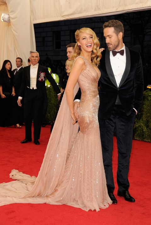 Gown, Red carpet, Carpet, Dress, Flooring, Clothing, Formal wear, Suit, Fashion, Hairstyle,