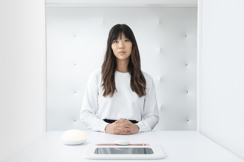 White, Skin, Sitting, Technology, Electronic device, Room, Photography, Neck, Long hair, Electronics,