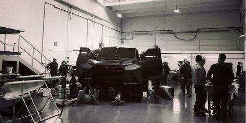 Motor vehicle, Vehicle, Car, Automotive design, Automobile repair shop, Machine, Factory, Subcompact car, Auto mechanic, Service,