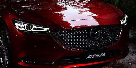 Land vehicle, Vehicle, Car, Automotive design, Grille, Auto show, Mid-size car, Mazda, Automotive lighting, Headlamp,