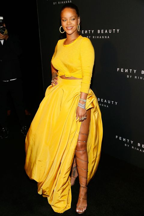 Fashion model, Clothing, Yellow, Dress, Shoulder, Hairstyle, Fashion, Joint, Gown, Cocktail dress,