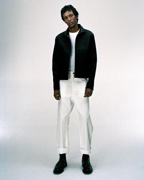 White, Clothing, Suit, Fashion, Formal wear, Blazer, Standing, Outerwear, Fashion model, Neck,