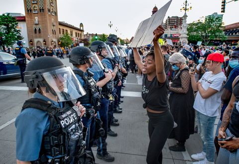 people protesting police brutality and the death of george floyd  standoff with police as they gathered friday, may 29, 2020, at the country club plaza in kansas city  protests have been erupting all over the country after george floyd died earlier this week in police custody in minneapolis