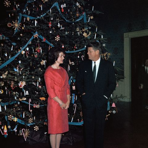 Jacqueline and John Fitzgerald Kennedy Posing with Their Christmas Tree