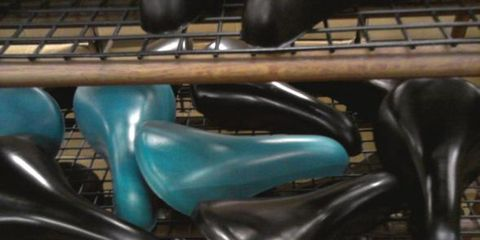 Teal, Aqua, Gloss, Material property, Metal, Close-up, Steel, Musical instrument accessory, Bicycle saddle, Plastic,