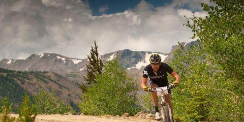 Tire, Wheel, Bicycle wheel, Mountain bike, Sports equipment, Bicycle frame, Mountain biking, Mountainous landforms, Recreation, Cross-country cycling,