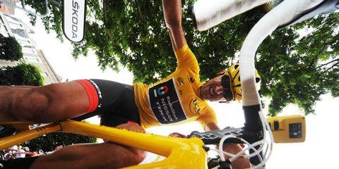 Yellow, Bicycle handlebar, Human leg, Cycling shorts, Bicycle, Bicycle part, Bicycles--Equipment and supplies, Bicycle frame, Endurance sports, Thigh,