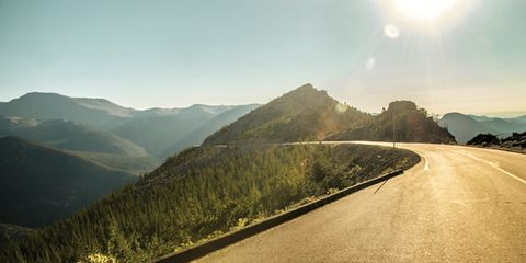 Road, Mountainous landforms, Infrastructure, Sun, Road surface, Highland, Mountain range, Natural landscape, Asphalt, Hill,