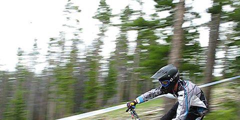 Clothing, Wheel, Motorcycle helmet, Helmet, Shoe, Sports gear, Bicycle, Rim, Personal protective equipment, Extreme sport,