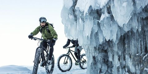 Cold Weather Riding: man riding fat bike in snow
