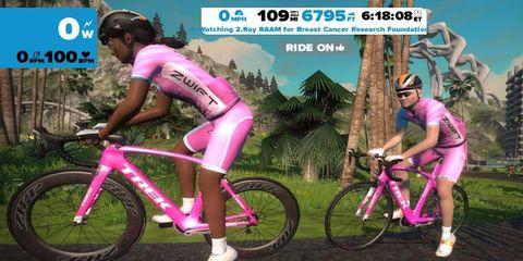 (Zwift: RAAM Ray's character on Zwift pedaling)