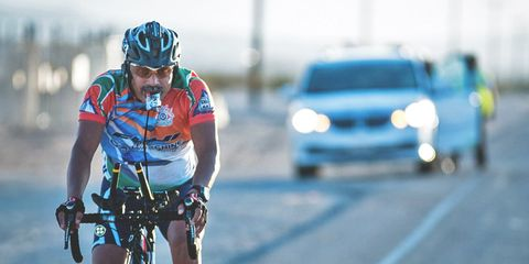 race across america cyclist fueling with an energy gel