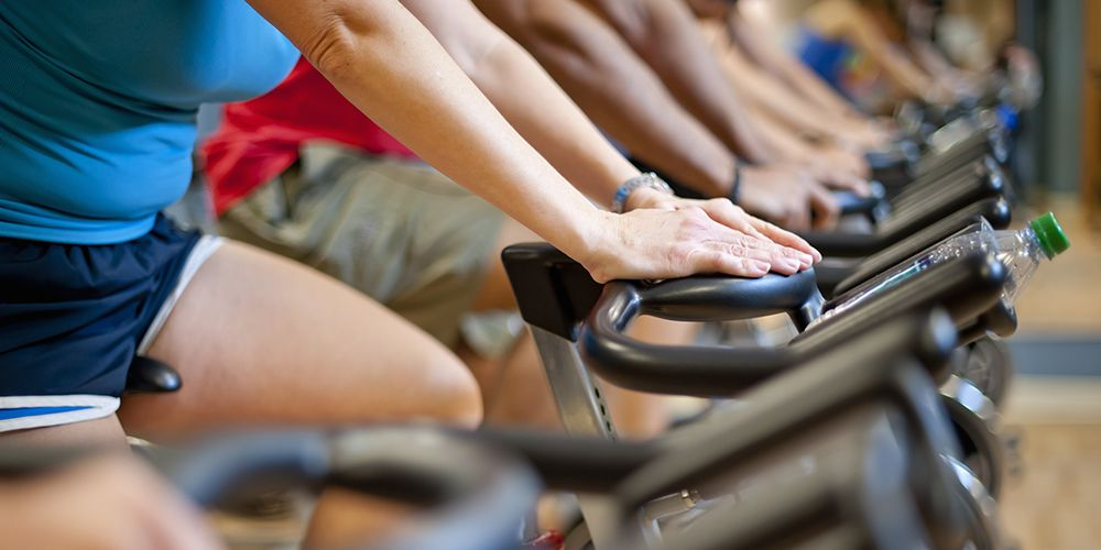 cyclists taking indoor spin class