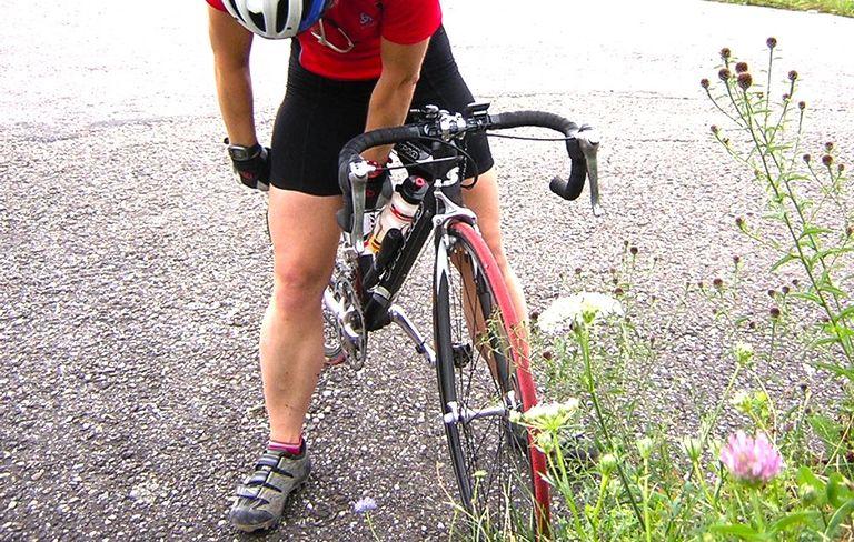 Cyclist Adjusting Cycling Shorts