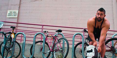 A man by a bike rack.