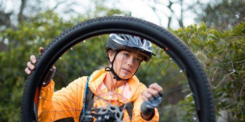 woman working on a bike