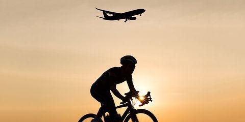 cyclist airport airplane dawn