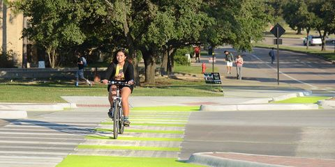 Texas A&M University glowing Dutch Junction cycling infrastructure