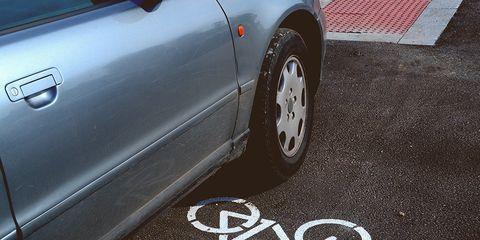 car parked in bike lane