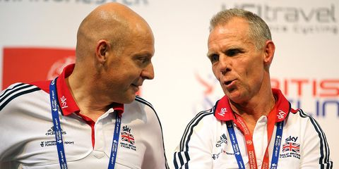 Sir Dave Brailsford, ex-British Cycling Perfromance Director, speaks with ex-Head Coach Shane Sutton on day three of the UCI Track Cycling World Cup at Manchester Velodrome on November 3, 2013.