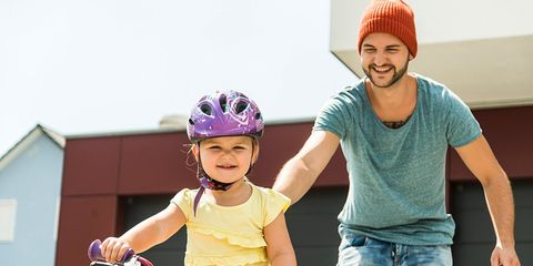 france helmet law young girl dad learning to ride bike