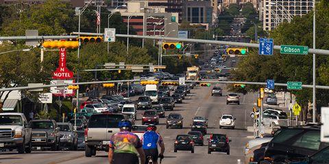 cyclists ride through downtown austin texas