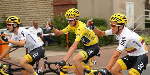 chris froome winning 2017 tour de france drinks champagne with teammates