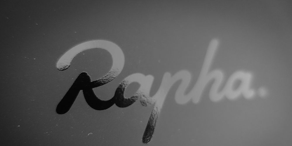 Shiny Black Rapha Logo on a Matte Black Background