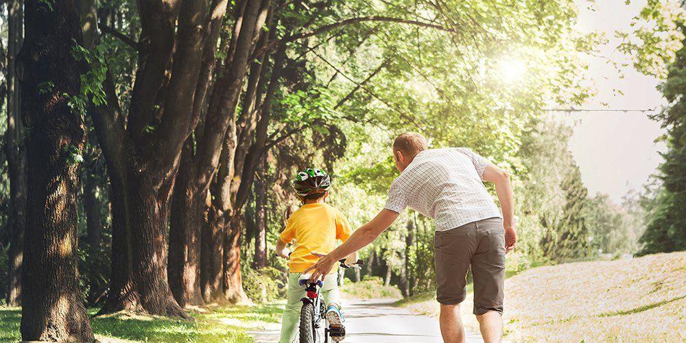 teaching child to ride bike