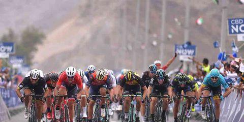 cyclists biking in a sprint finish