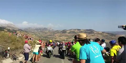 Cop Pushes Man In Front of Motorcycle at Vuelta