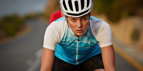 woman cycling hard