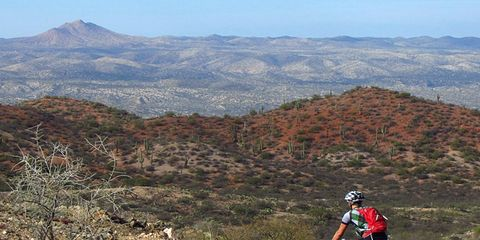 Mountain bike rider climbing through some beautiful desert scenery