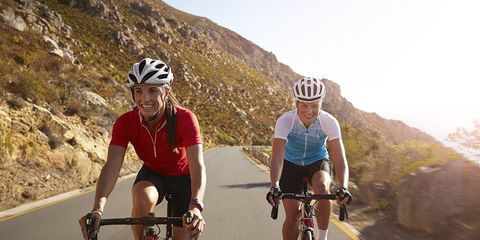 women cycling on highway in bike kit