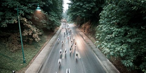 group of riders cruise through the forest at the whistler gran fondo