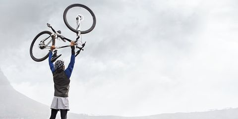 cyclist at the top of a mountain