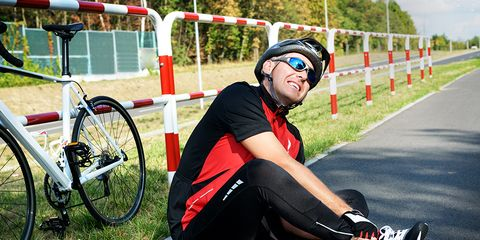 injured middle-aged cyclist