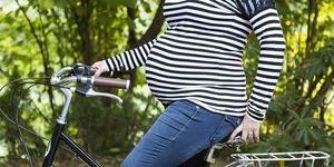 pregnant woman on a bicycle