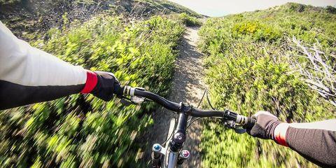 cyclist filming trail ride